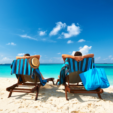 Honeymoon_Couple_Relaxing_Beach-1.jpg