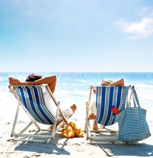 honeymoon_couple_relaxing_on_beach-1.jpg