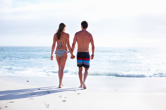 honeymoon_couple_walking_on_beach-1.jpg